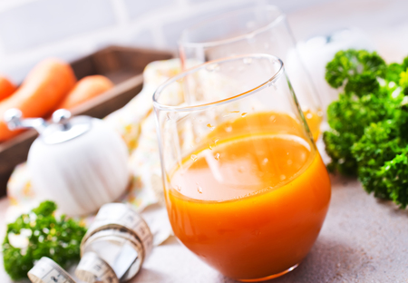 A glass of fresh carrot smoothie, carrot juice