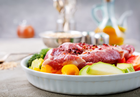 raw meat with vegetables on plate, ingredients for dinner
