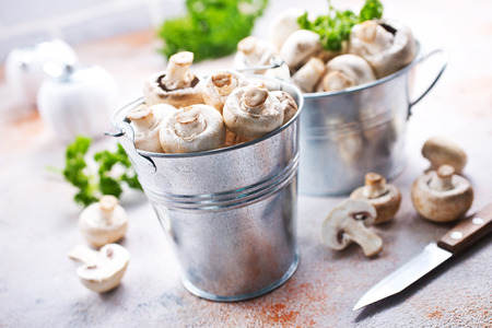 raw mushrooms in metal bucket, champignons in bucket