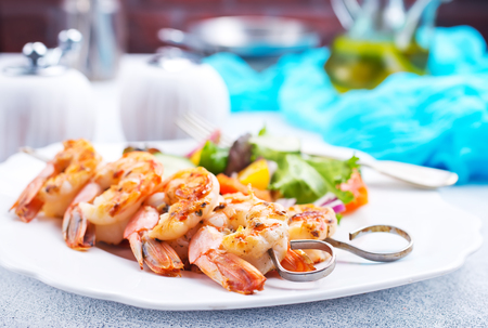 fried shrimps with salad, fried shrimps on sticks