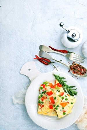 omelette with vegetables, breakfast on a table 写真素材