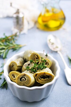 Artichoke hearts in white bowl , Artichoke hearts with marinade