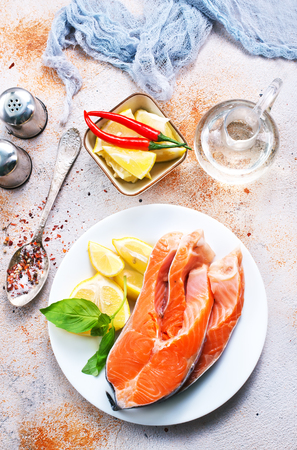 raw salmon and fresh lemon on the plate Stock Photo