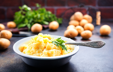 portion of mashed potatoes with butter on a plate