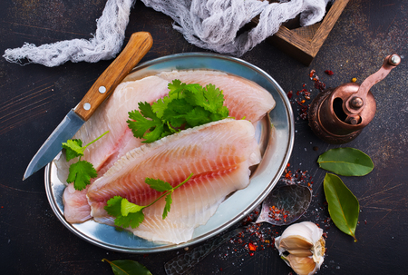 raw fish fillet with aroma spice on plate Stock Photo