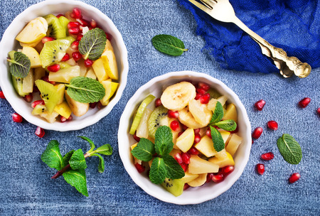fruit salad in bowls on a table, portions of fresh salad
