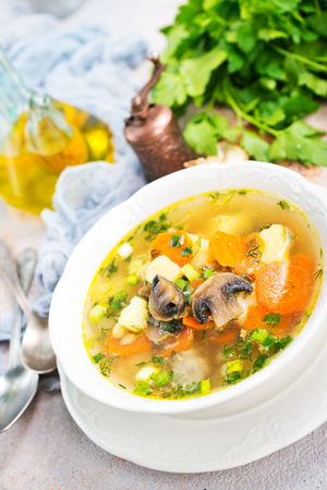 soup with vegetables and mushrooms and fresh greens