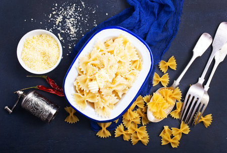 Pasta sprinkled with cheese , pasta in bowl