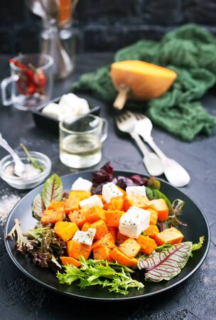 salad with fried pampkin and feta cheese, portion of salad with pampkin