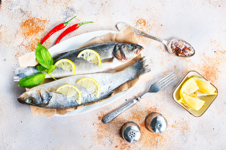 raw fish with spice and salt, fish with  lemon and aroma herb Stock Photo