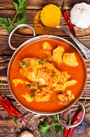 Traditional Indian dish chicken. Spicy chicken curry in bowl Stock fotó
