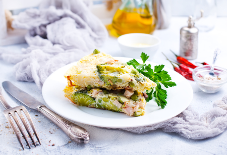 omelette with vegetables on white plate, stock photo