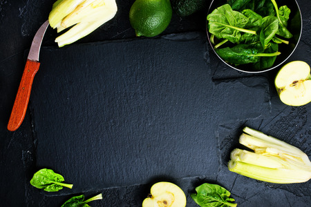 Composition of green vegetables on dark table Stock Photo