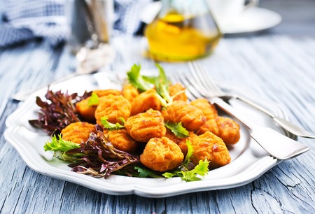 chicken nuggets with salad on plate, fried chicken 写真素材