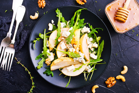salad with fresh pear spinach nuts, diet food,stock photo