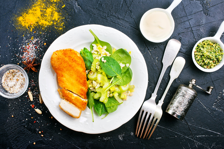 chicken breast with fresh salad, fried chicken breast with spinach and celery
