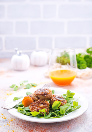 cutlets with sauce and fresh salad, cutlets on white plate Banco de Imagens
