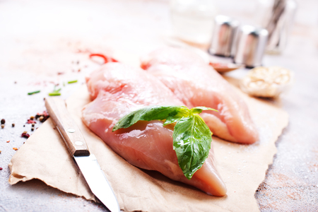 raw chicken fillet with spice and salt. chicken fillet on board, stock photo Stok Fotoğraf - 98256147