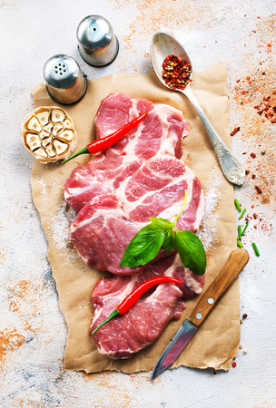 raw meat with spice and salt, raw meat on paper Stock Photo