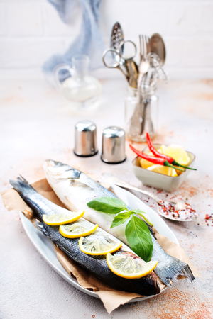 raw fish on plate, fish and aroma spices Banco de Imagens - 98256319