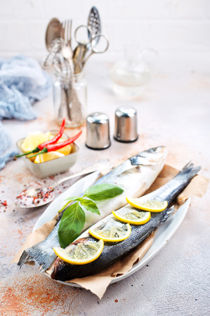 raw fish on plate, fish and aroma spices Banco de Imagens - 98256373