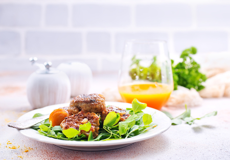 cutlets with sauce and fresh salad, cutlets on white plate Stock Photo