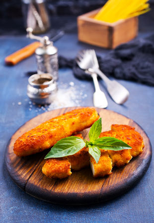 fried chicken breast on wooden board on a table 写真素材