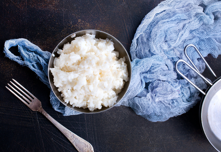 boiled rice in bowl and on a table Stock Photo