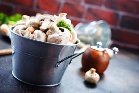 raw mushrooms, raw champignons, champignons on a table, stock photo