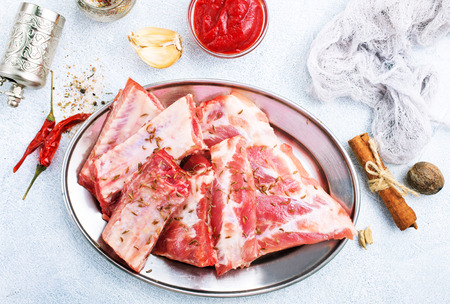 uncooked lamb or beef ribs with pepper  garlic salt,raw ribs