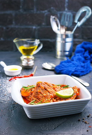 fish with tomato sauce and aroma spices Фото со стока