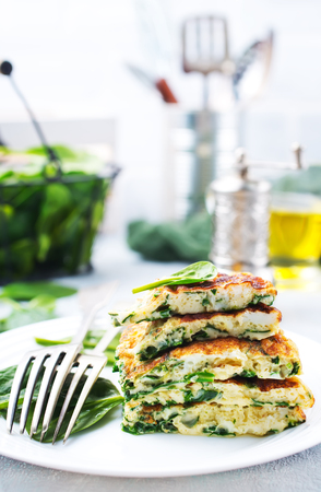 omelette with spinach leaves, diet food, omelette on plate Stock fotó