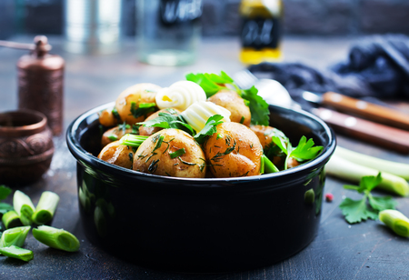 boiled potato with fresh greens and butter