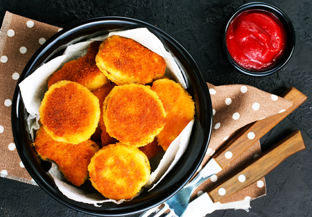 nuggets with tomato sauce on plate