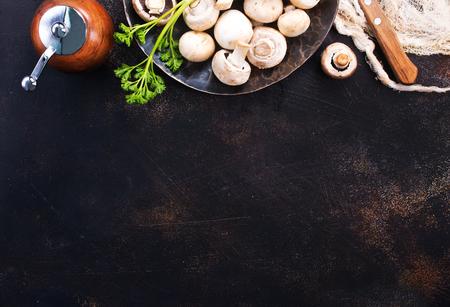 raw mushrooms, raw champignons, champignons on a table Stockfoto