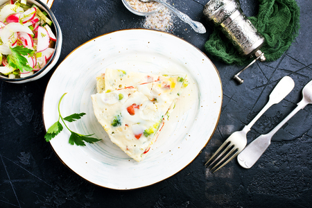 omelette with vegetables on plate, diet food Stock Photo