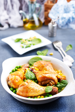 baked chicken legs with corn and green peas Stock Photo - 104296623
