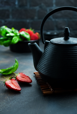 Tea with fresh basil and strawberry, fresh herbal tea