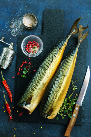 smoked fish, fish with red pepper, fish on the board Stock Photo