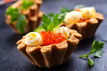 tartalets with butter and salmon caviar, fresh salmon with butter