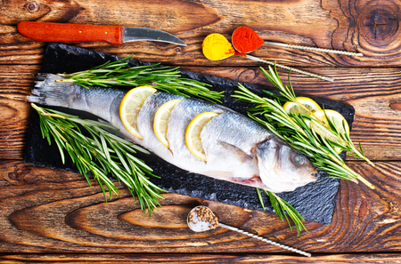 Fish,raw fish, fish with salt and spices Banco de Imagens - 104297635