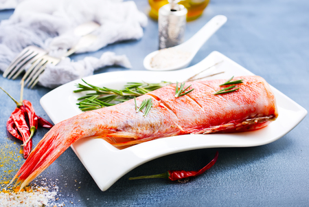 raw fish with aroma spice and salt, ocean perch on white plate Imagens