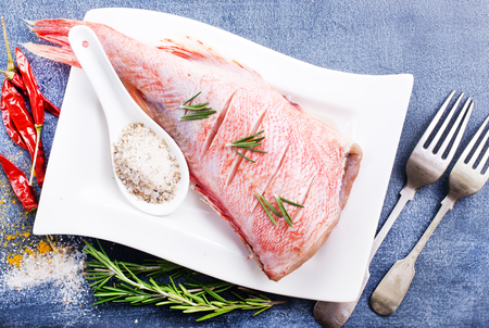 raw fish with aroma spice and salt, ocean perch on white plate Stok Fotoğraf