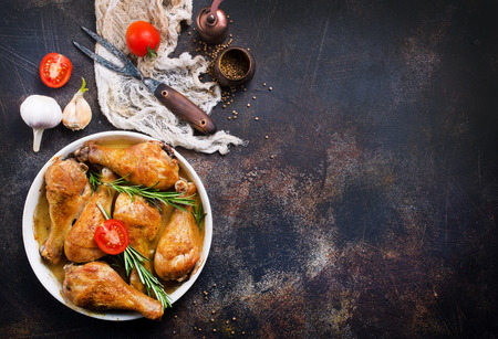 baked chicken legs with vegetables and spices