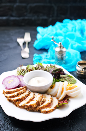baked meat with salad and sauce, diet food Imagens