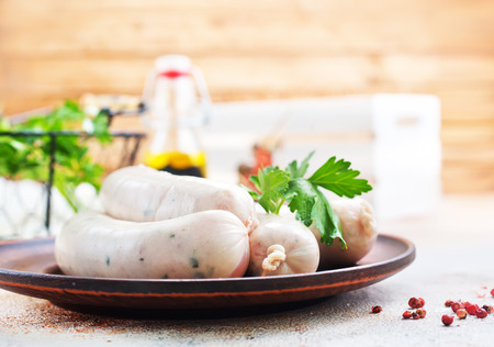 white sausages on plate and on a table