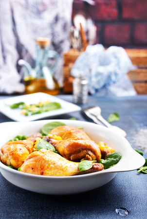 baked chicken legs with corn and green peas Stock Photo - 104298370