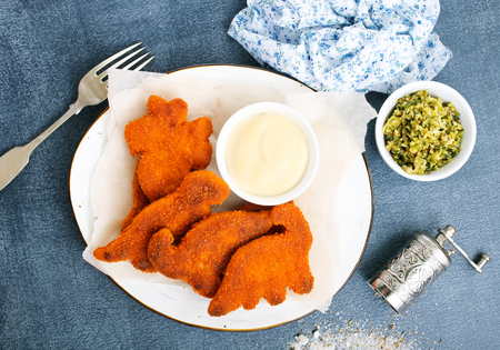 fish nuggets with sauce, fast food on a table