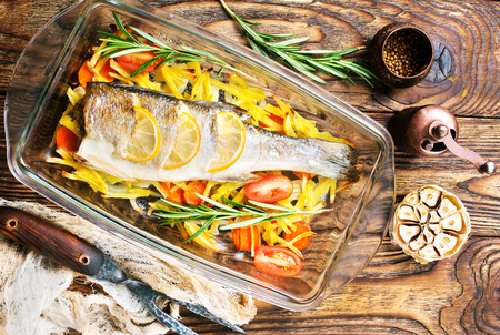 baked fish, baked fish with vegetables on plate