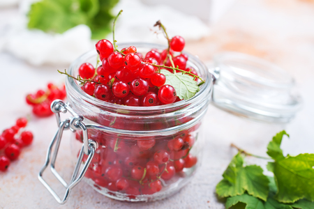 red currant in glass bank, fresh currant Фото со стока